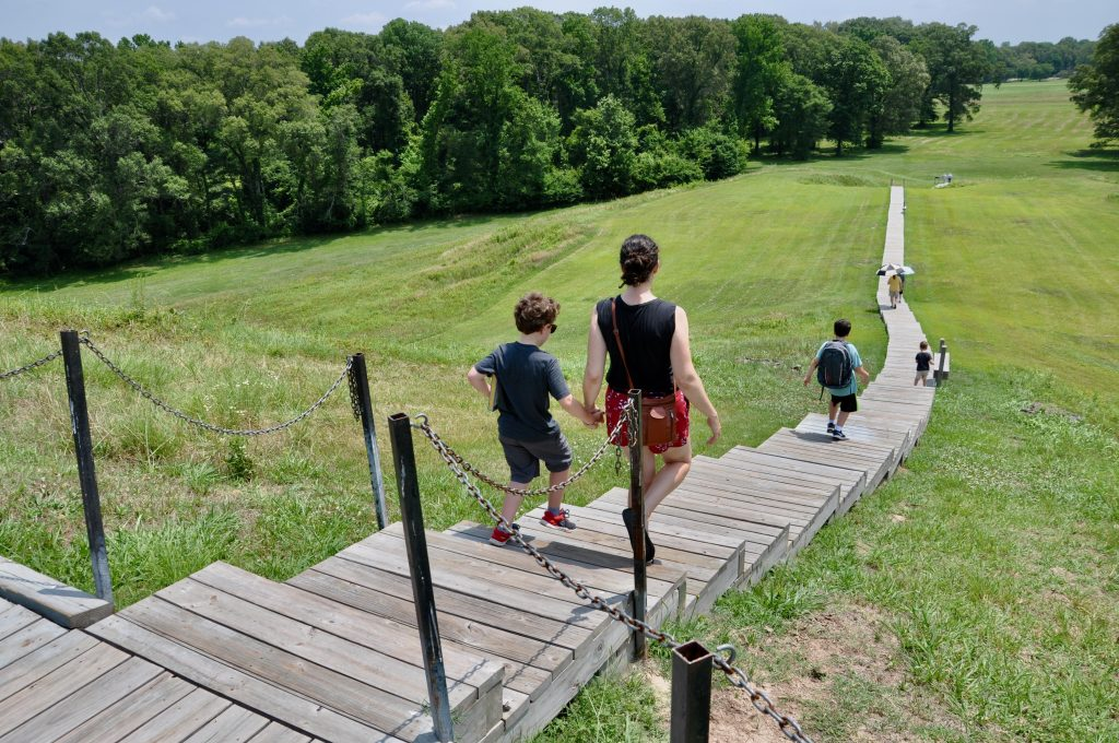 People walking down the steps at Poverty Point's Mound A.